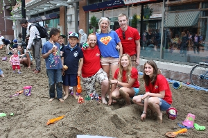 Team CHEO and their superheroes play in the sandbox