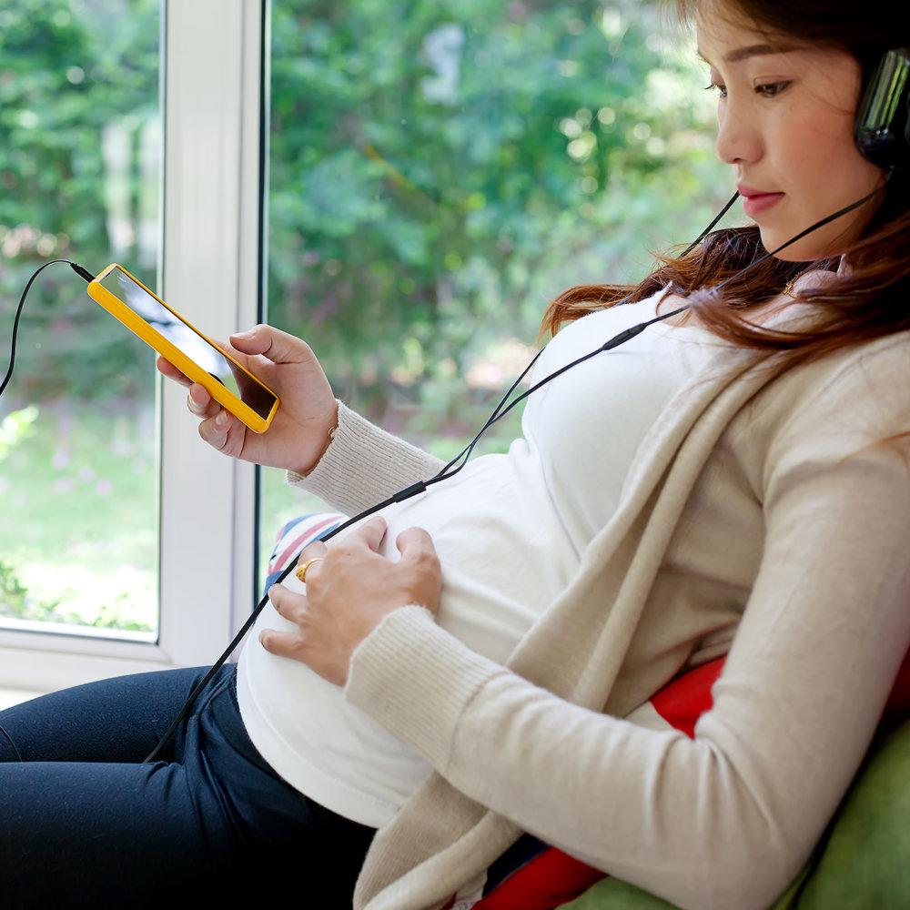 Woman with headphones Square.jpg