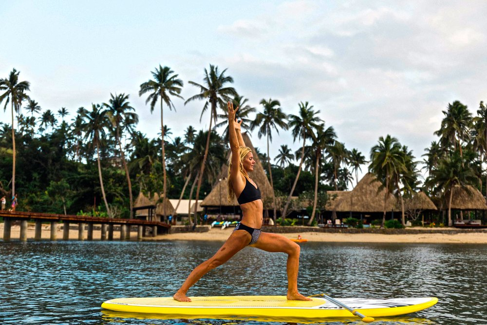 Ellen has found numerous ways to continue her dedicated daily yoga practice while being on this journey. Since a Modo hot yoga studio is not always nearby, she often times has to get creative to fit her practice in. Here she is practicing on a stand up paddle (SUP) board at the Jean- Michel Cousteau resort in Savusavu, Fiji. From the reaction of the amazing staff and hotel guests, I don't think they have ever seen anyone perform Warrior pose and more in the ocean before.
