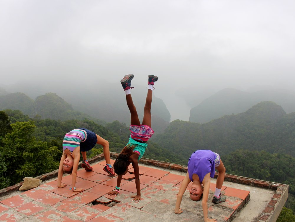 "After a 3 hour hike just shy of 10 miles, climbing limestone rock and thru the jungle, the girls were ""flipping out"" and ""bending over backwards"" that they made it to the peak!!!! These 3 strong girls led the way and amazed our local guide."