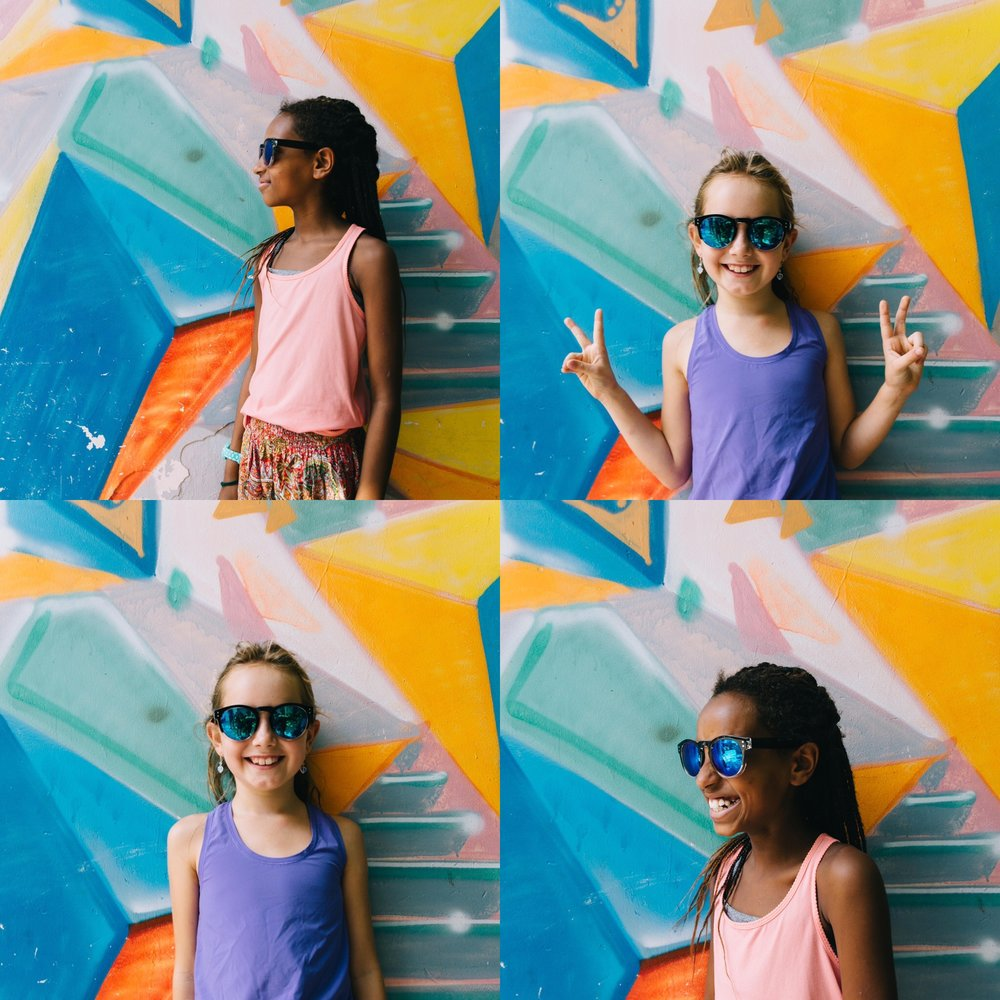 The paparazzi caught these 2 striking a pose on our Saigon graffiti art tour. Walking thru the less travelled alleyways of Ho Chi Minh City, to discover these beautiful colors and the unique and meaningful works of art, was a great family experience.