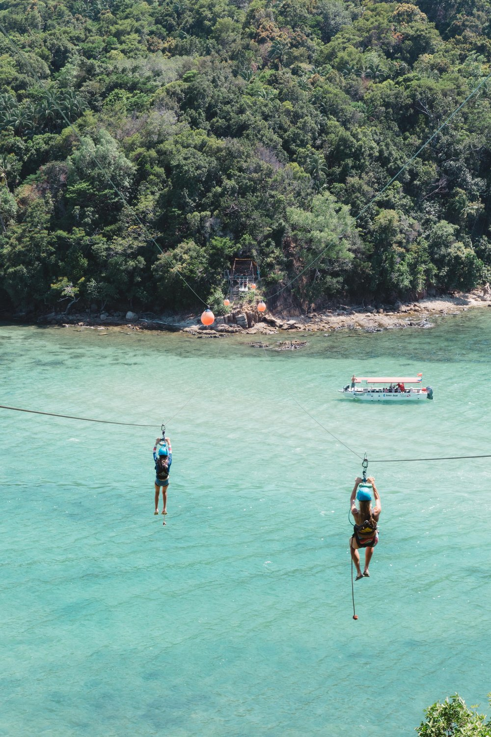 Our new preferred mode of transportation!!!!!! So much fun taking the longest island to island zip-line in the world, while enjoying a day trip snorkeling in Kota Kinabalu, Malaysia. What a pretty view to take in mid-fight!