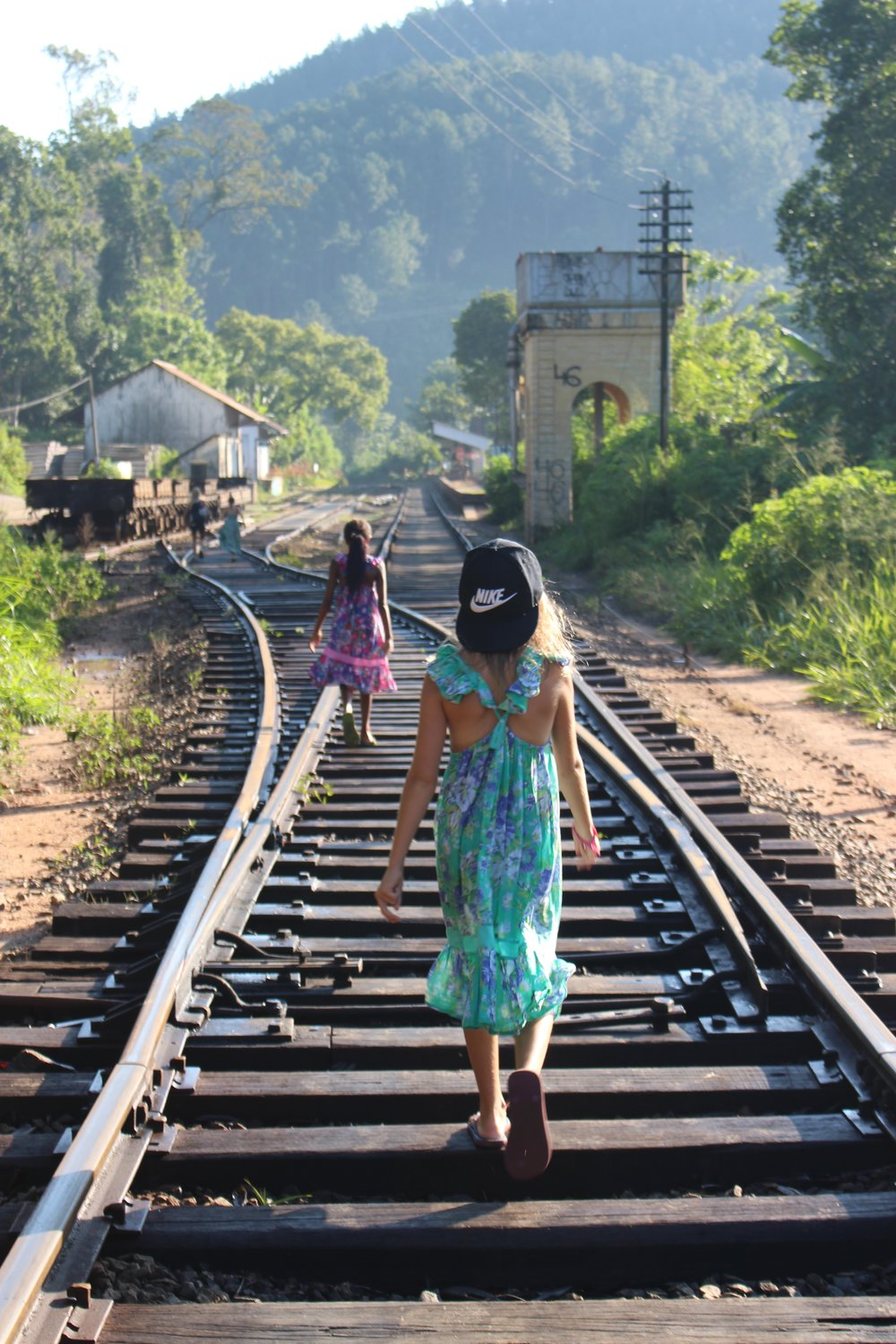 Morning walk to the iconic 9 Arches Bridge using the train tracks in Ella, Sri Lanka. The beautiful hill country, full of lush tea plantations, was so much fun to explore by foot and train. Not many in the fashion industry can pull of a beautiful dress and backwards athletic hat like Shae can! This journey has made us all stronger, closer and wiser, and opened our creative minds  more than we could have ever imagined, style included.