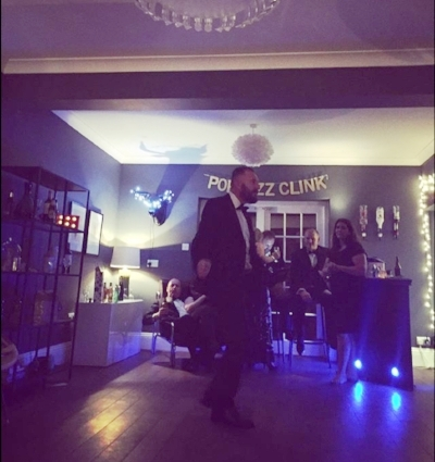 The eternal Pop Fizz Clink banner at our Christmas party last year.  For those who follow  @upnorthcreative , this is John dancing to Al Wilson's The Snake at 2am.  He's such a hipster.
