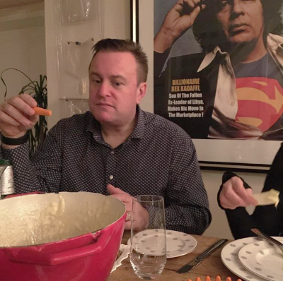 Joe eating fondue in front of 'Fruitcake' from Bob Dylan's Revisionist Collection.  Cool as f**k.