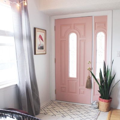 The pale pink door and boho accessories add the edge to the entrance hall of Cara Irwin, writer of Goldalamode blog.
