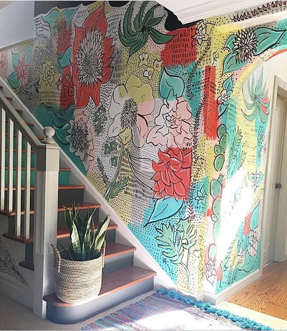A hand painted mural and stairs make Jen  Streeter's hallway stand out.   Damn, this girl is GOOD.