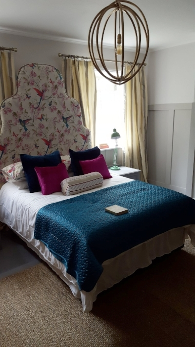 The fabulous upholstered headboard in the room Oliver created in the Cheltenham Regency townhouse.