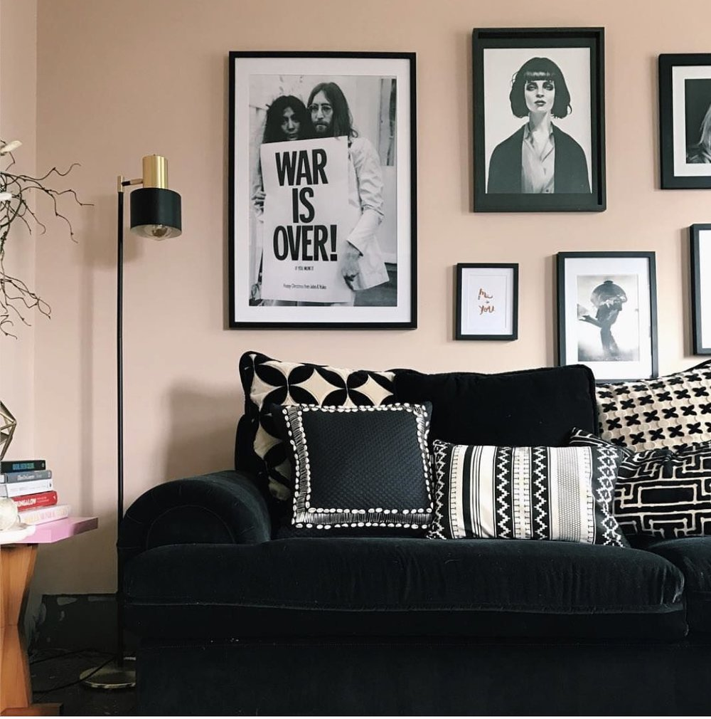 Michelle Matangi 's monochrome artwork and furniture look perfect against her blush walls.