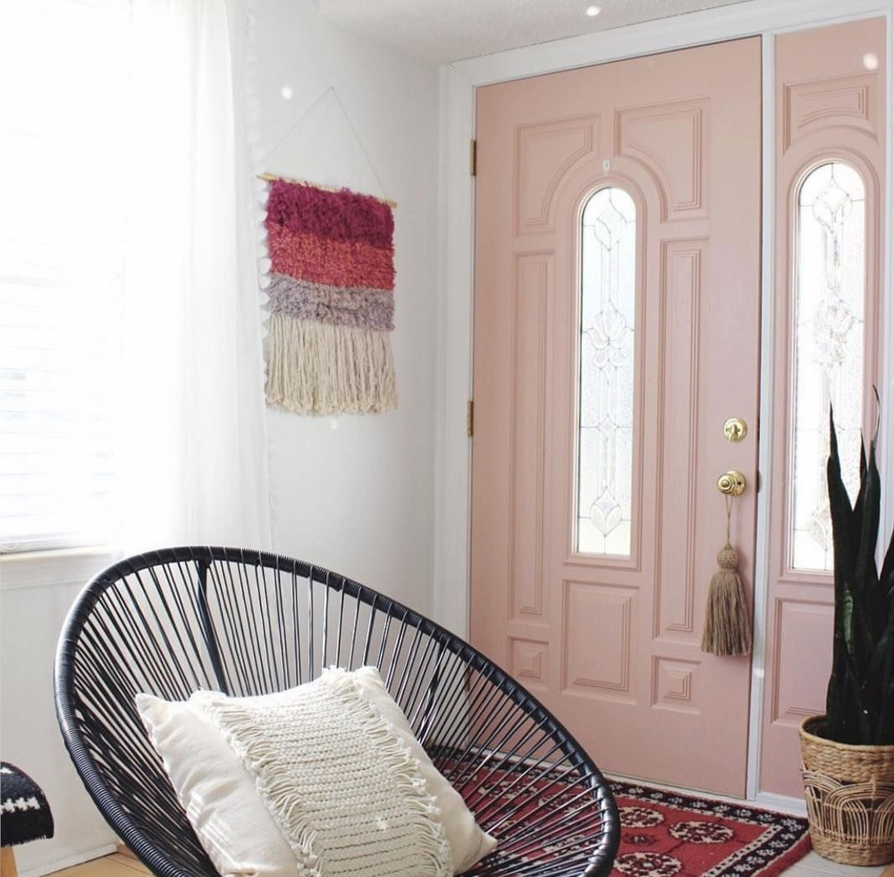 Cara Irwin of  Goldalamode  blog has used pink to make her front door stand out from the pale walls.