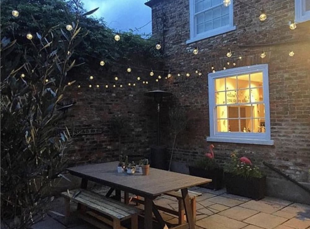 My courtyard with enough festoon action to taken down North Yorkshire's electrical supply.
