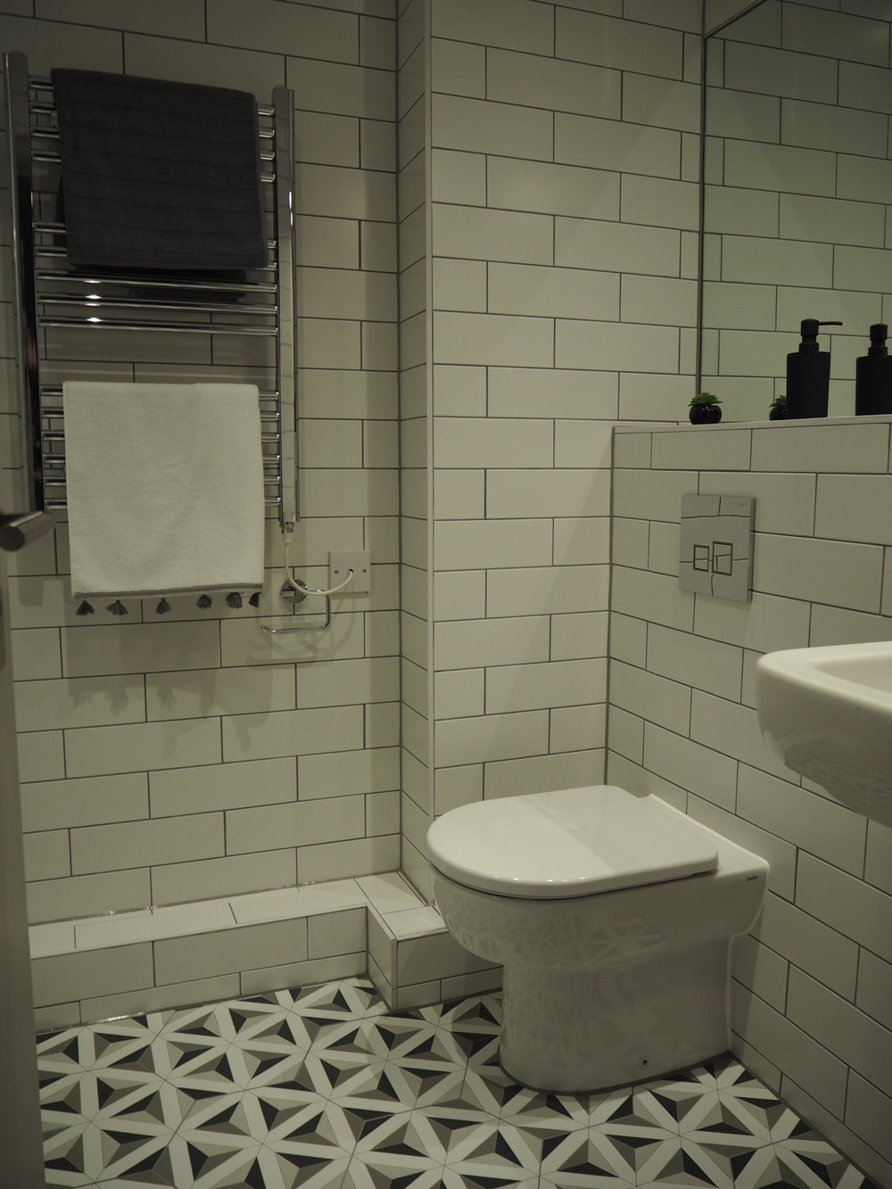 Fully tiled bathrooms and cool sanitaryware.