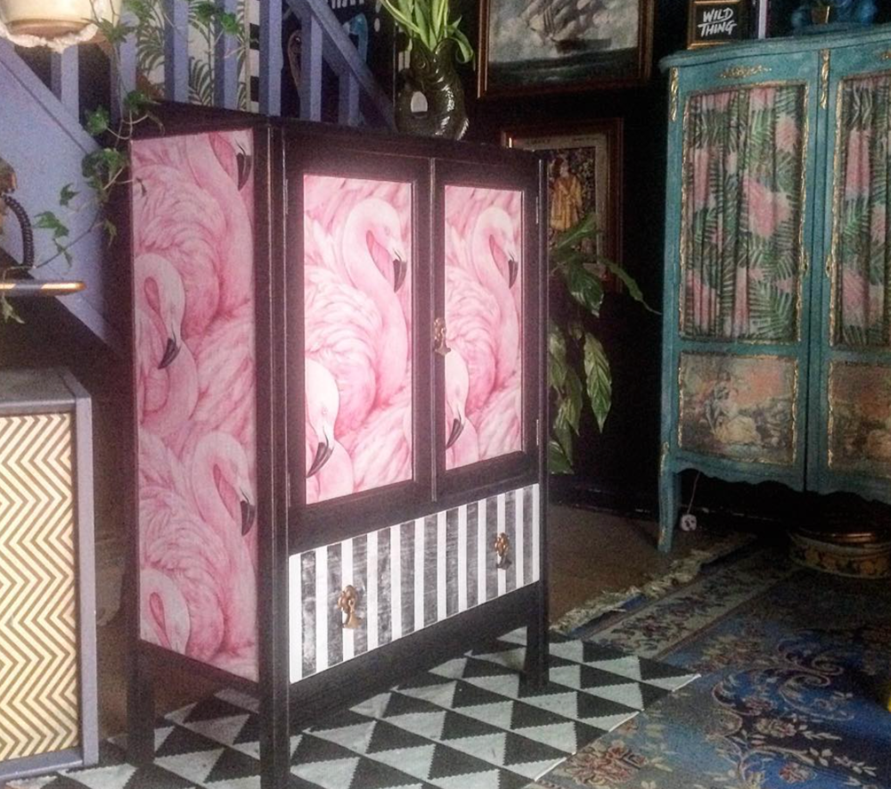 Wallpaper takes this cabinet up to another level.  Marcie K Designs.
