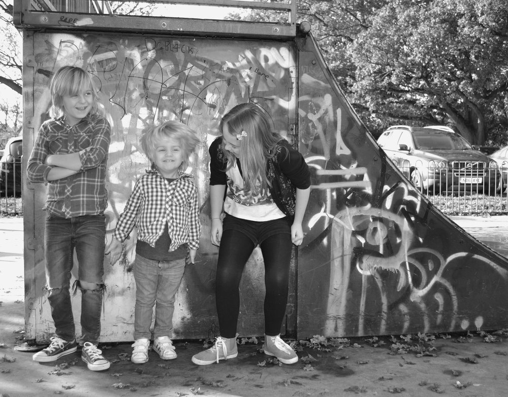 Me attempting to get my kids to pose in cool clothes.  It was around this time that the boys had a long hair uprising.  I am not embarrassed to admit that I cried when it went.