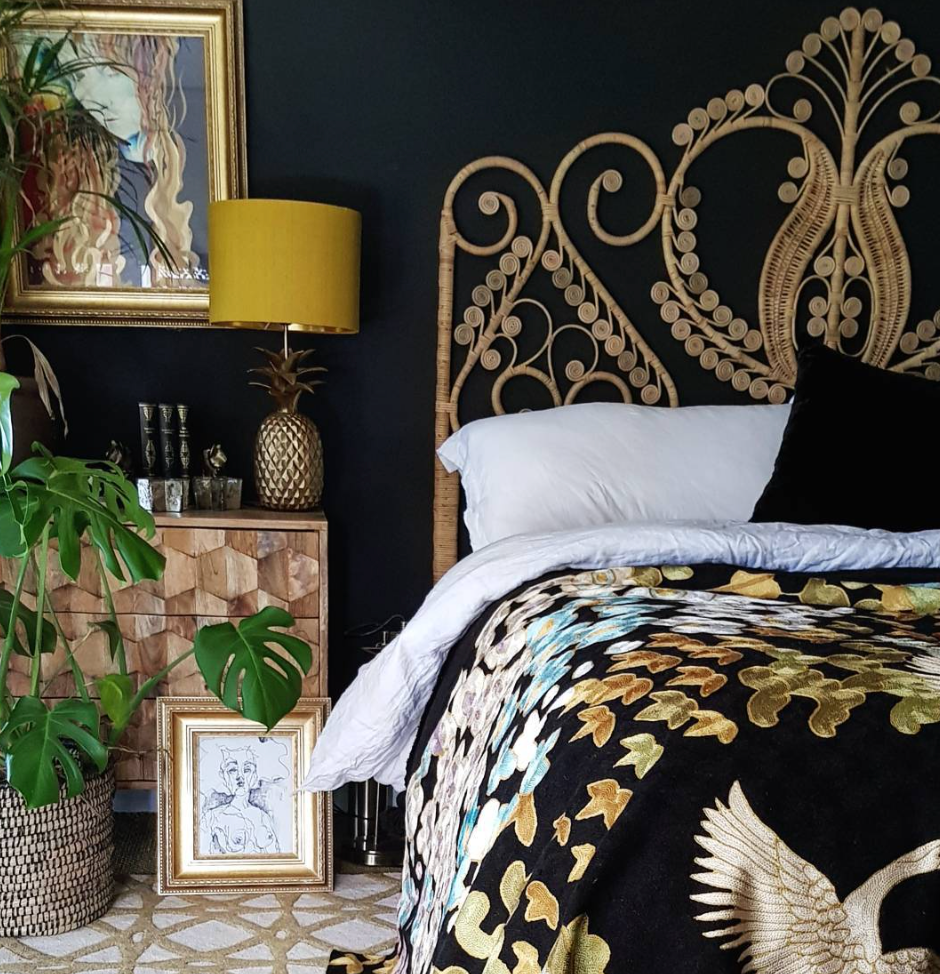 This ornate headboard is the perfect contrast to Cowboy Kate's dark decor.
