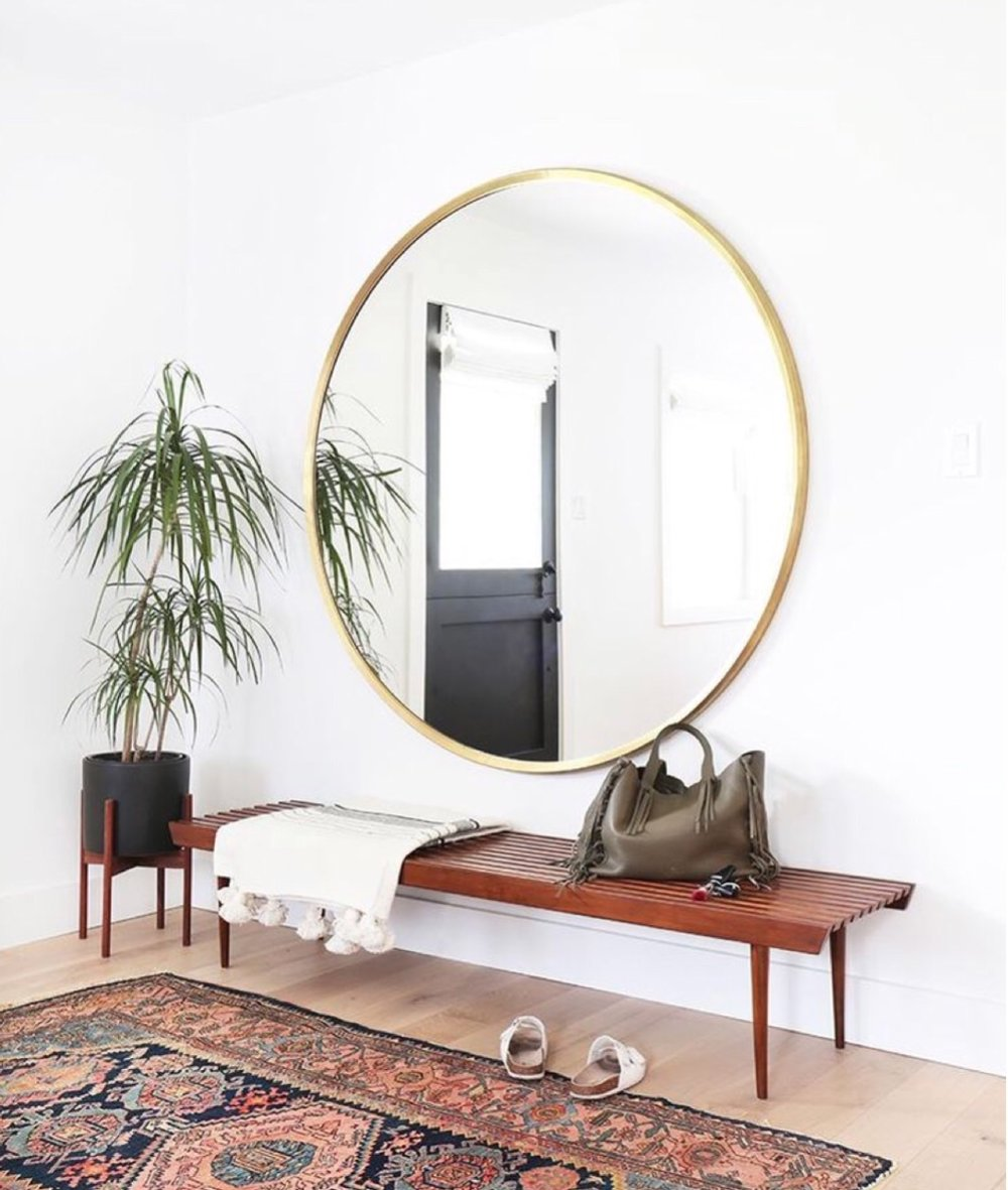 A big mirror, round or rectangular, is a must have.  Selfie City.  Designed by  Amber Interiors .