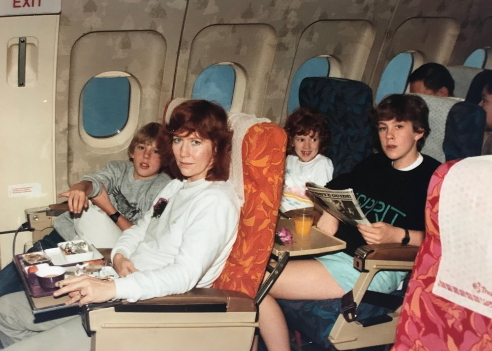 1984: Living in Hong Kong as a child, we spent a lot of time on planes. Check out my Mum's fag on board situ.