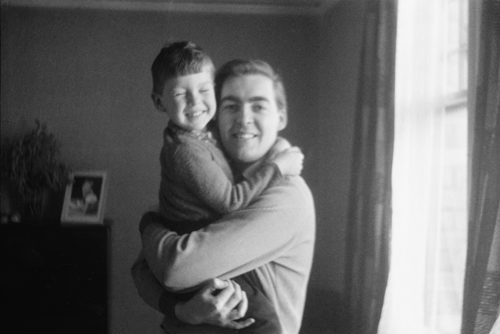 Kevin with son Michael in their Broadhurst Gardens flat next to Decca studios, 1965