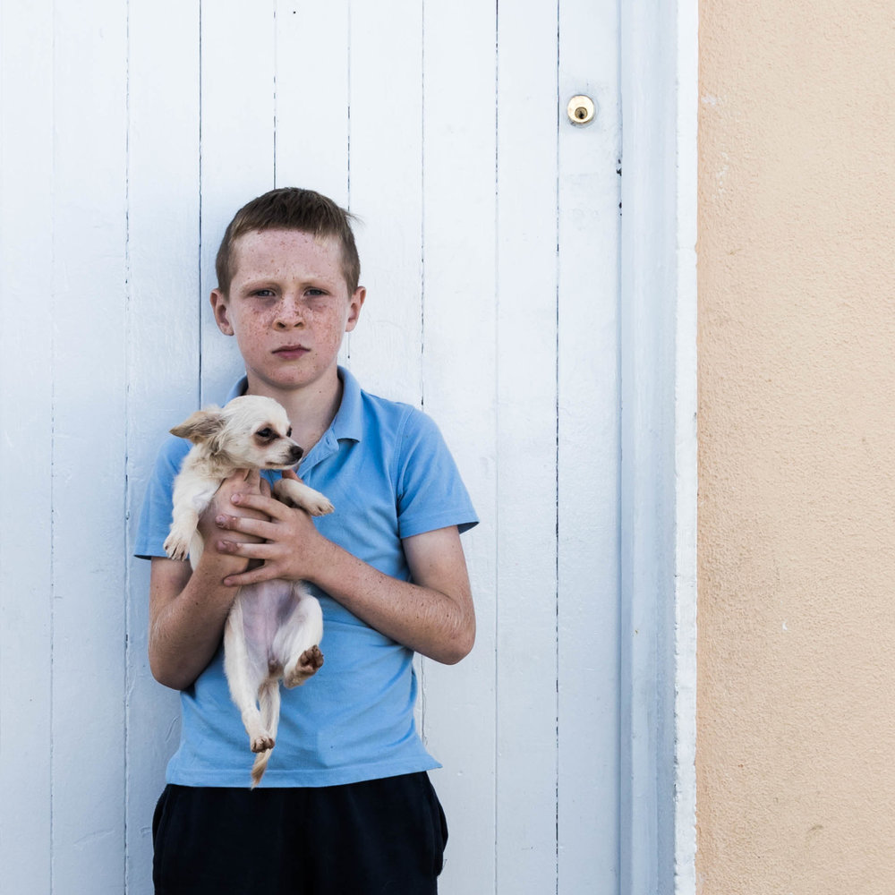 Irish Traveller Boy with Puppy