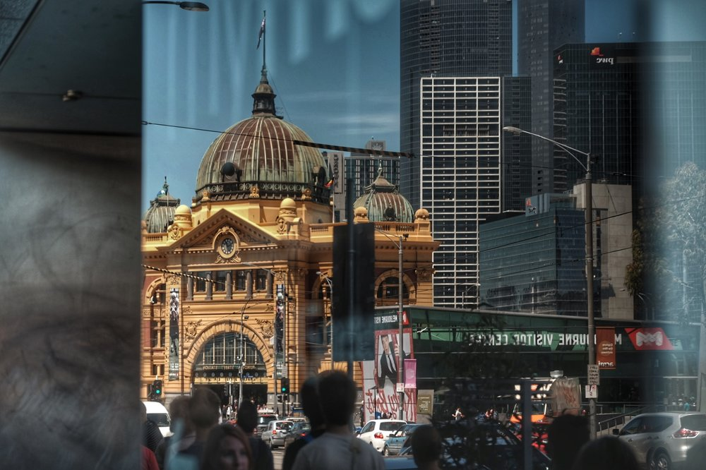 Reflection of Federation Square and Flinders Street Station.