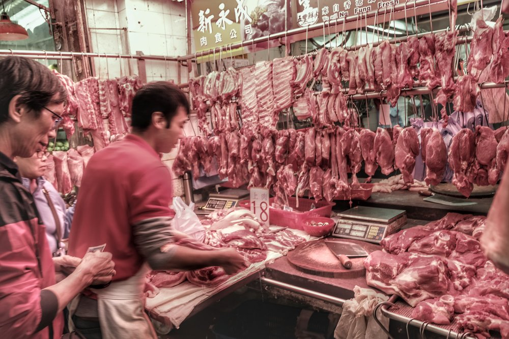 Butcher at local market.