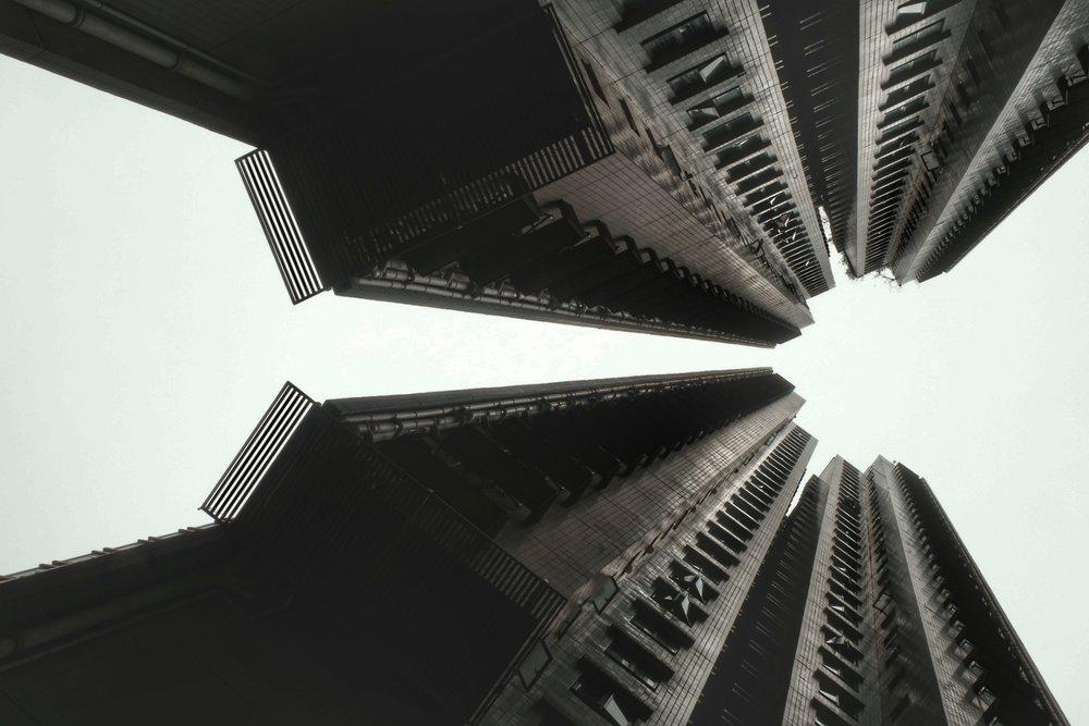 Looking skywards between buildings.