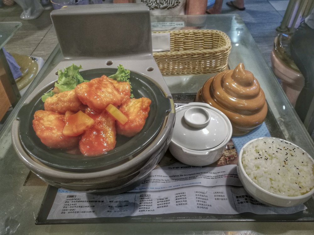 Main course served in miniature toilet bowl.