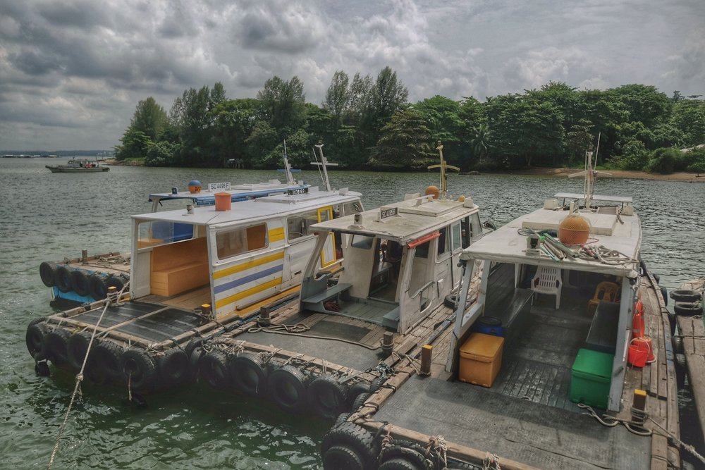 Bum boats docked on pier of Pulau Ubin.