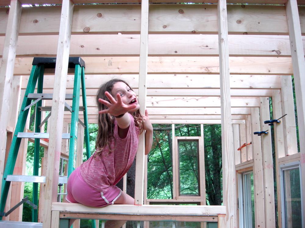 Caroline climbing on the frame