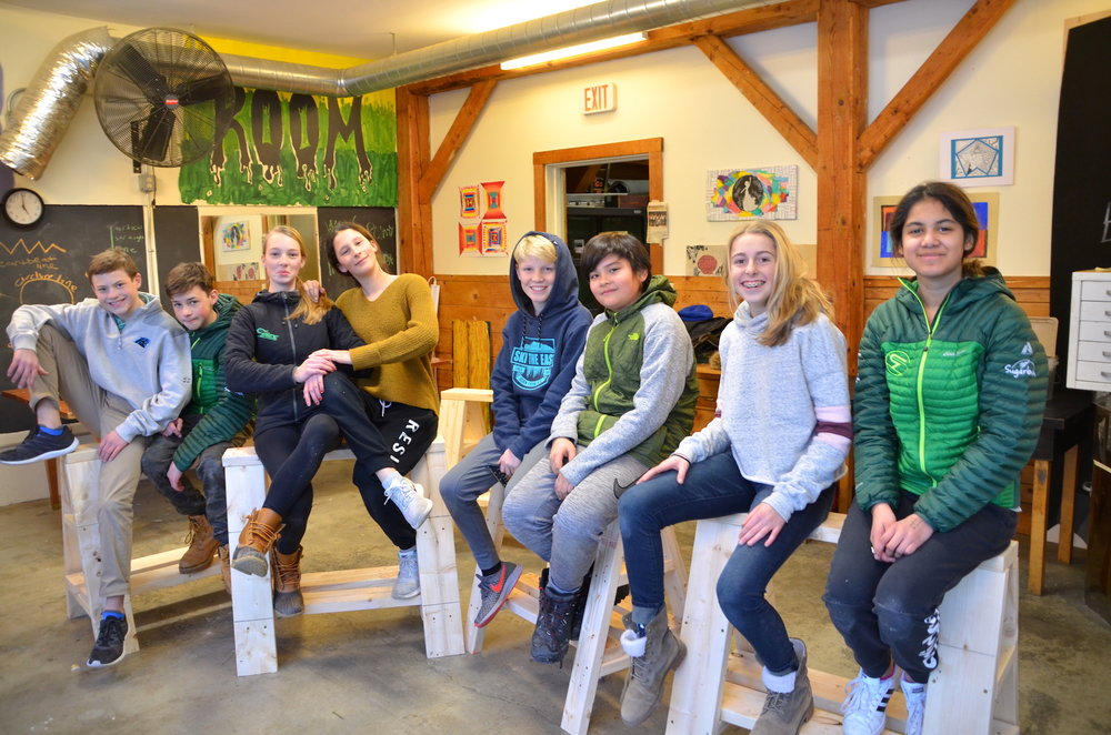 7th graders sitting proudly on their sawhorses.