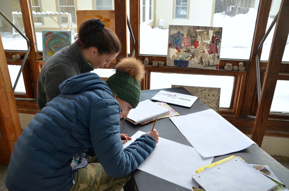 Whitney and Ellie drawing their ideas for a play kitchen.
