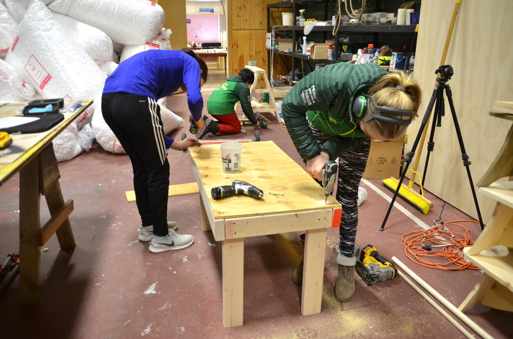 Ellie and Whitney working together on a play kitchen prototype.