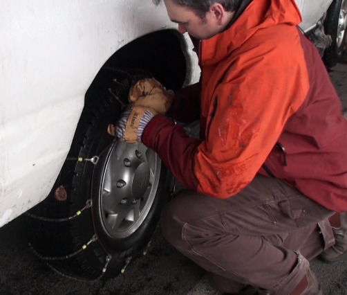 Asa applying tire chains to drive one mile to the convention centre in Portland.