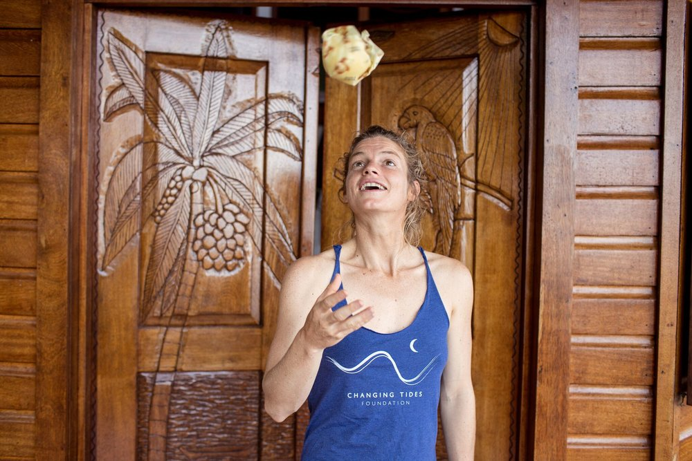 Honoring her food with Khala Cloths in Bocas del Toro Archipelago in Panama, pro-surfer Leah Dawson gives a toss to some local fruit wrapped in an original line Khala Cloth. Photo courtesy of @barkerfoto