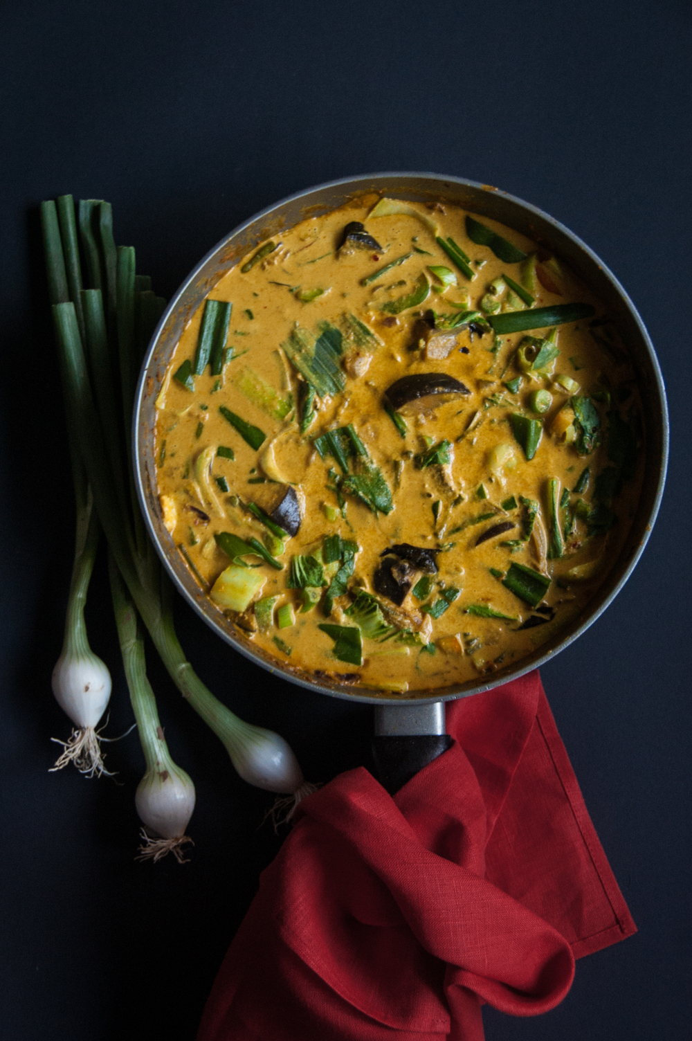 A vegan yellow curry with coconut sauce