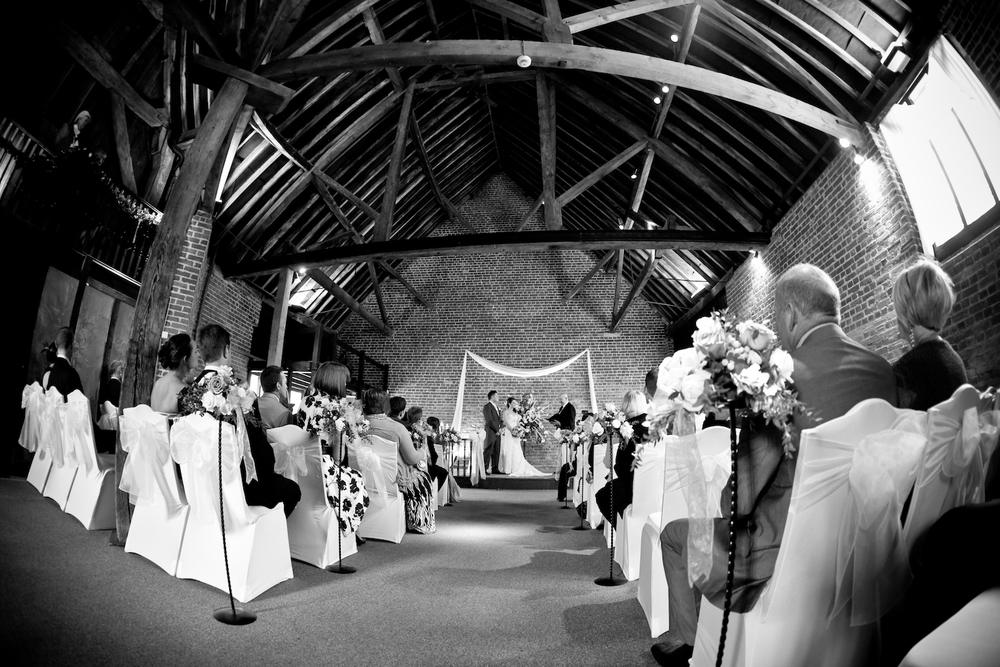 Wedding ceremony taking place in the fathom barn