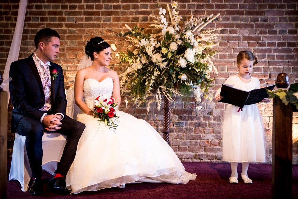 Little girl doing a reading during a wedding ceremony