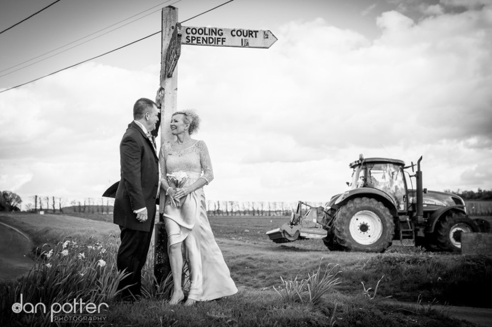 countryside wedding showing farmers tractor