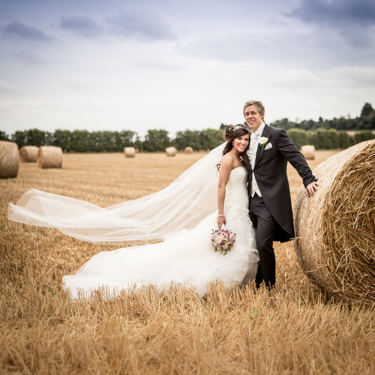 bride and groom in the corn fields