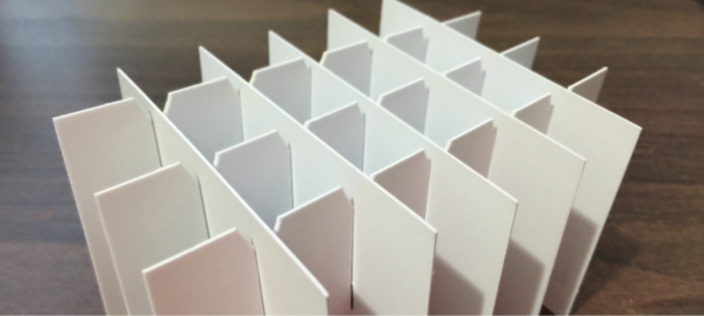 Cell partitions and divider sets for boxes cartons