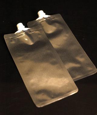 Flat foil squeeze spout bags