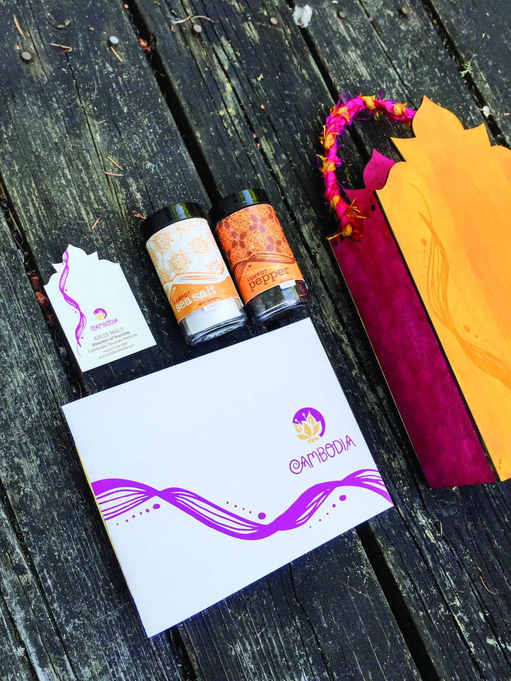 Brand book, business card, spices and laser etched and hand-painted gift bag with silk braided handles.