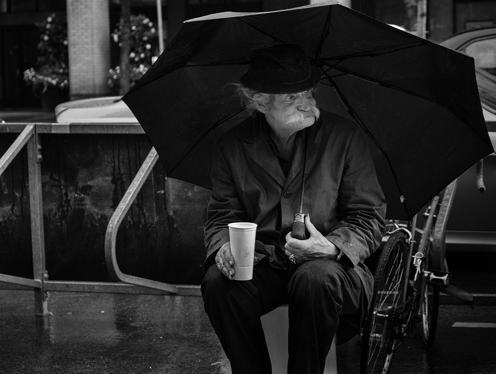 Rainy day panhandler