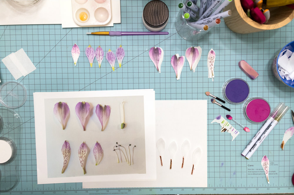Above right, you can see the stacks of photocopied petals I used for my templates with my cut petals below.