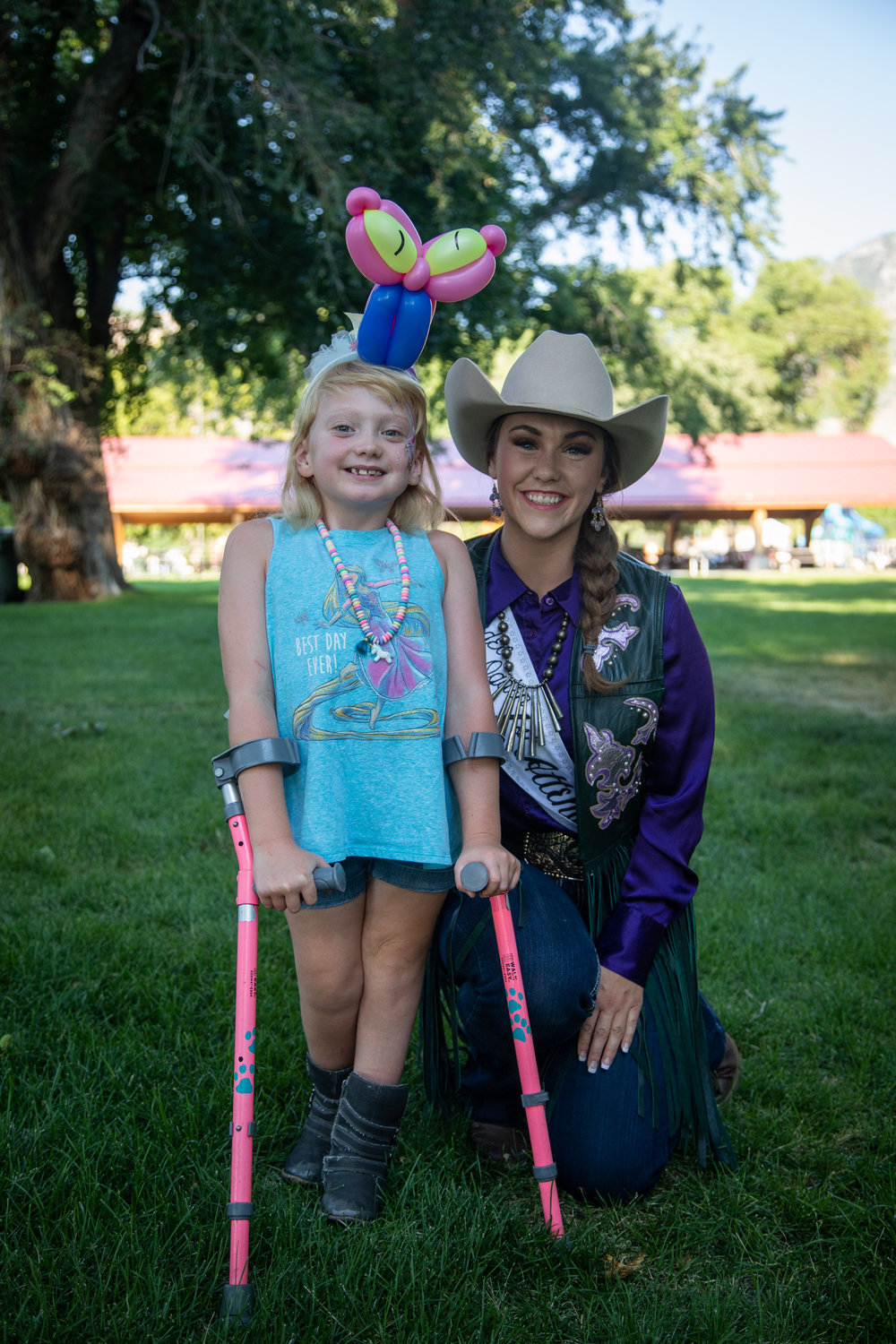Allison McKay, 7, and Jayna Scadden, first attendant, at the Special Kids Rodeo on Tuesday evening, July 17, 2018, in Lorin Farr Park.