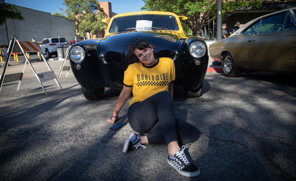 Charlotte Puckett matches a yellow and black 1948 Studebaker Starlight at the 2018 Ogden Car Show on June 1, 2018