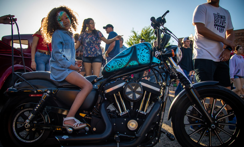 Gracie Smith, 5, sits on her mother's motorcycle at the 2018 Ogden Car Show in downtown Ogden on June 1, 2018.