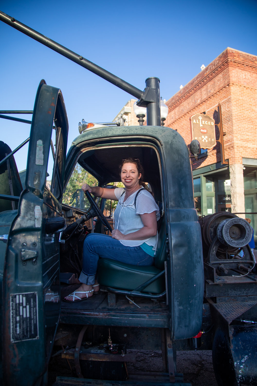 Jennifer Hansen sit in an old tow truck at the 2018 Ogden Car Show in downtown Ogden on June 1, 2018.