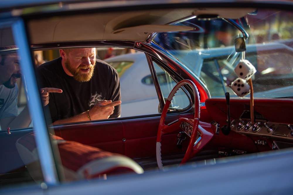 Kent Child peers into a 1961 Bubble Top Chevrolet Impala at the 2018 Ogden Car Show in downtown Ogden on June 1, 2018.