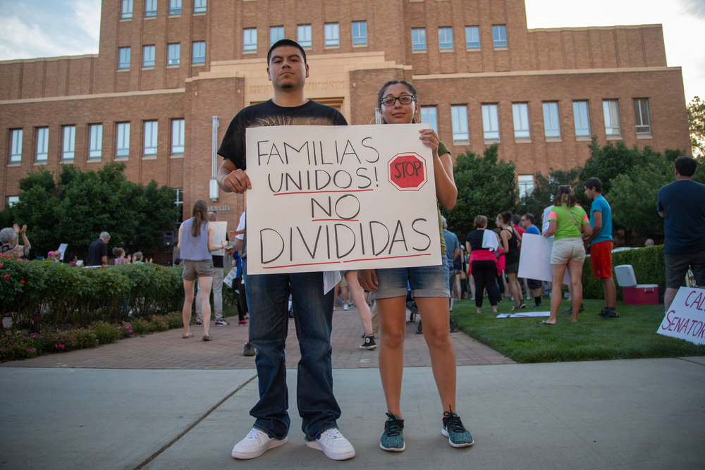 Jaime Contreras, 19, and Marcela Rodriguez, 20, join community members Wednesday, June 27, 2018 at the Ogden Municipal Building for a rally to protest family separations at the U.S.-Mexico border.